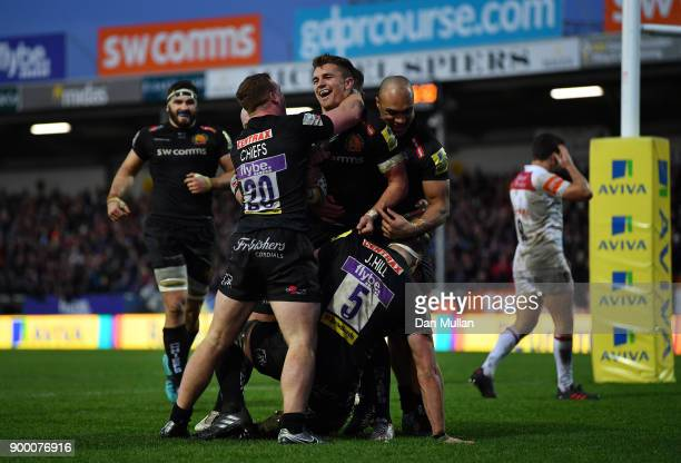 Henry Slade of Exeter Chiefs celebrates with his team mates after scoring his side's second try during the Aviva Premiership match between Exeter...