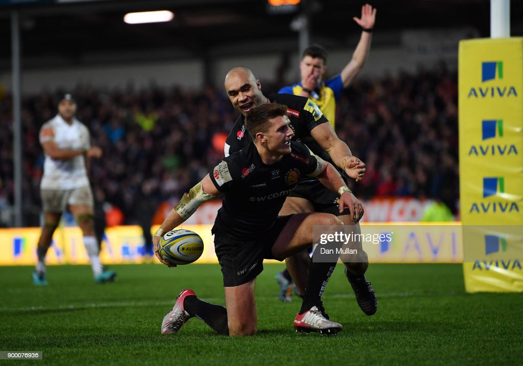 Henry Slade of Exeter Chiefs (c) celebrates with his team mates after scoring his side's second try during the Aviva Premiership match between Exeter Chiefs and Leicester Tigers at Sandy Park on December 31, 2017 in Exeter, England.