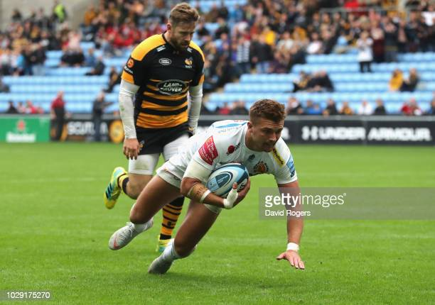 Henry Slade of Exeter Chiefs dives over for his second try during the Gallagher Premiership Rugby match between Wasps and Exeter Chiefs at Ricoh...
