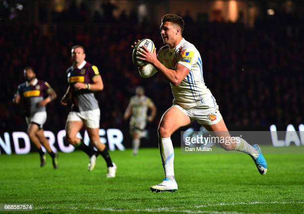 Henry Slade of Exeter Chiefs gathers the ball and crosses the line to score his side's fourth try during the Aviva Premiership match between...