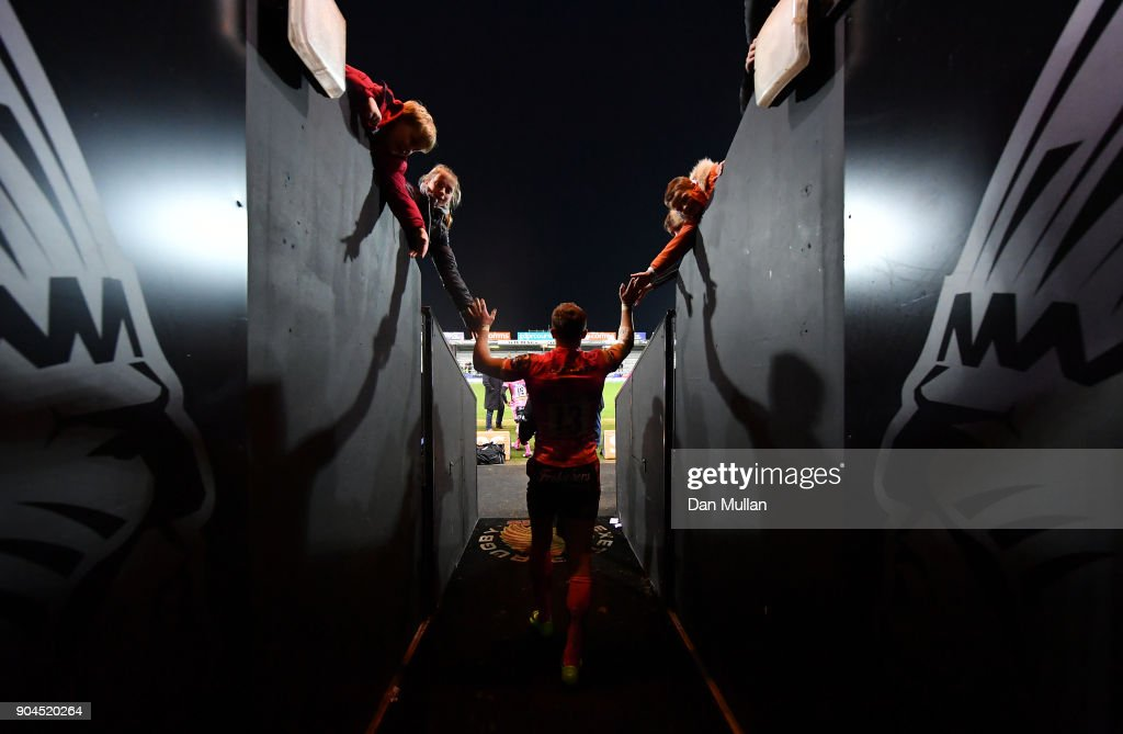 Henry Slade of Exeter Chiefs high fives young supporters following during the European Rugby Champions Cup match between Exeter Chiefs and Montpellier at Sandy Park on January 13, 2018 in Exeter, England.