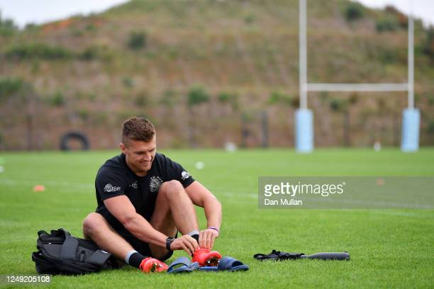 Henry Slade of Exeter Chiefs laces his boots prior to a training session at Sandy Park on June 12, 2020 in Exeter, England. Exeter Chiefs were...