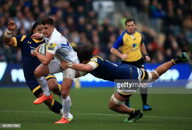 Henry Slade of Exeter is tackled by Chris Vui of Worcester during the Aviva Premiership match between Worcester Warriors and Exeter Chiefs at Sixways...