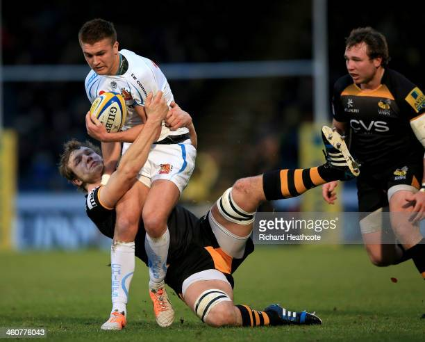 Henry Slade of Exeter is tackled by Joe Launchbury of Wasps during the Aviva Premiership match between London Wasps and Exeter Chiefs at Adams Park...
