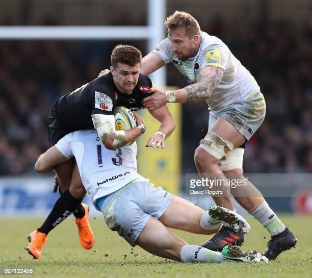 Henry Slade of Exeter is tackled by Marcelo Bosch and Dominic Day during the Aviva Premiership match between Exeter Chiefs and Saracens at Sandy Park...