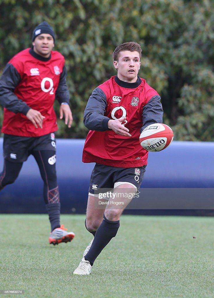 Henry Slade passes the ball during the England training session held at Pennyhill Park on February 2, 2015 in Bagshot, England.
