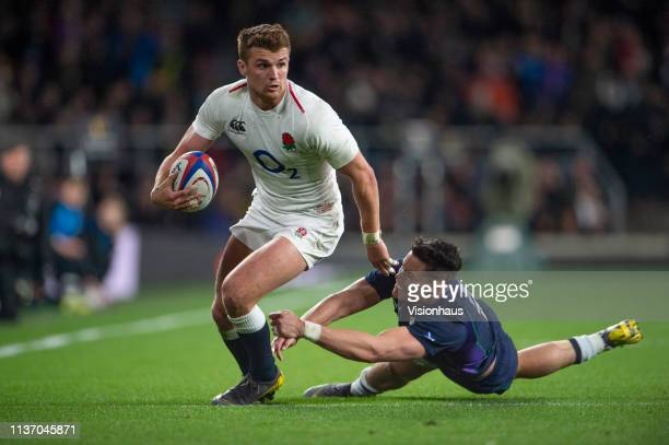 Henry Slade scores for England despite the efforts of Sean Maitland of Scotland during the Guinness Six Nations match between England and Scotland at...
