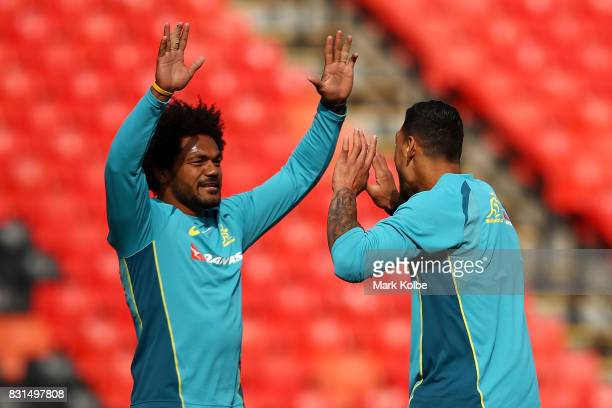 Henry Speight and Israel Folau celebrate after Folau kicked a field during an Australian Wallabies training session at Pepper Stadium on August 15...