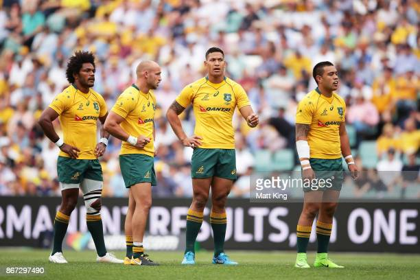 Henry Speight Bill Meakes Israel Folau and Duncan Paia'aua of the Wallabies talk during the match between the Australian Wallabies and the Barbarians...