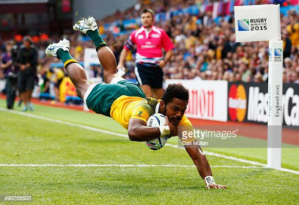 Henry Speight of Australia dives in to score their fourth try during the 2015 Rugby World Cup Pool A match between Australia and Uruguay at Villa...