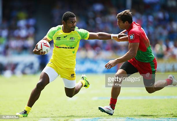 Henry Speight of Australia puts a fend on Tiago Fernandes of Portugal during the 20146 Sydney Sevens match between Australia and Portugal at Allianz...