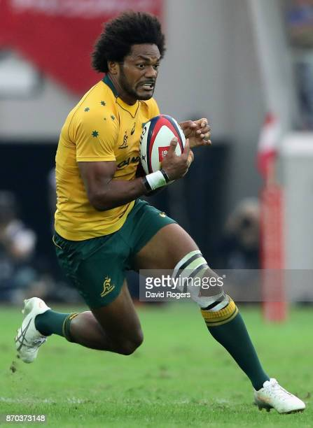 Henry Speight of Australia runs with the ball during the rugby union international match between Japan and Australia Wallabies at Nissan Stadium on...
