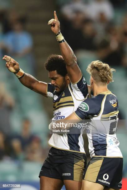 Henry Speight of the Brumbies celebrates with his team mate Jordan JacksonHope of the Brumbies after scoring a try during the round four Super Rugby...