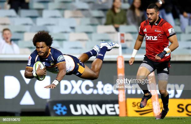 Henry Speight of the Brumbies dives to score a try during the round 11 Super Rugby match between the Brumbies and the Crusaders at GIO Stadium on...