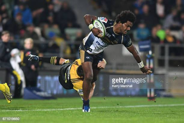 Henry Speight of the Brumbies is dragged into touch by Beauden Barrett of the Hurricanes during the round nine Super Rugby match between the...