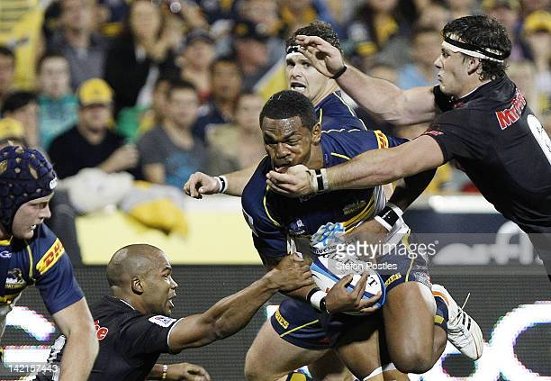 Henry Speight of the Brumbies is tackled by Marcell Coetzee of the Sharks during the round six Super Rugby match between the Brumbies and the Sharks...