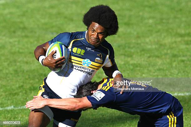 Henry Speight of the Brumbies is tackled during the Super Rugby trial match between the Highlanders and the Brumbies on January 31 2014 in Queenstown...