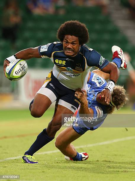 Henry Speight of the Brumbies looks to break from a tackle by Nick Cummins of the Force during the round three Super Rugby match between the Western...