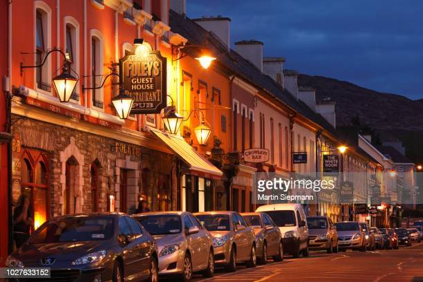 henry street at night, kenmare, ring of kerry, county kerry, ireland, british isles - henry street stock pictures, royalty-free photos & images