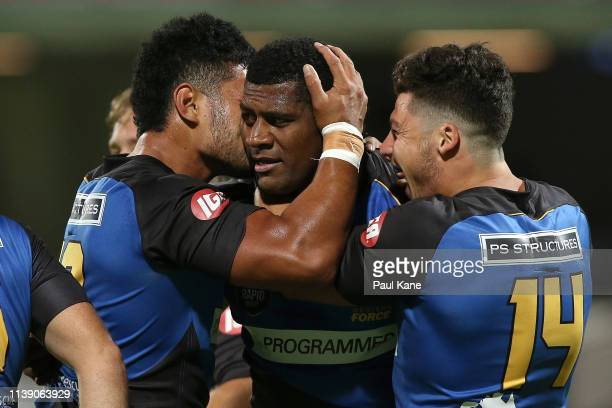 Henry Taefu and Clay Uyen of the Force congratulate Masivesi Dakuwaqa after crossing for a try during the Global Rapid Rugby match between the...