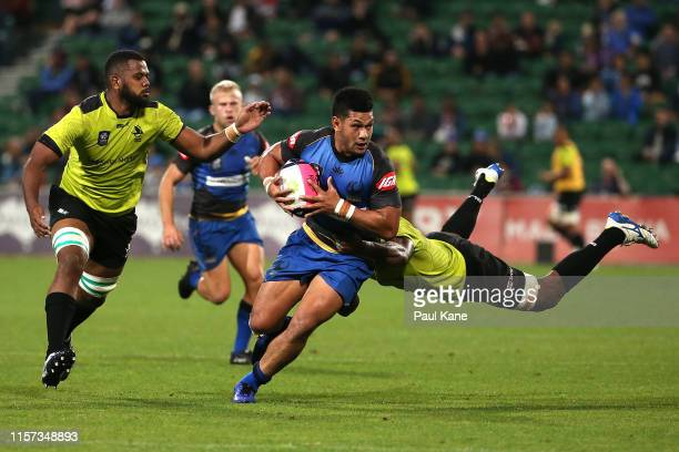 Henry Taefu of the Force attempts to break a tackle by Mosese Voka of Fijian Latui during the Rapid Rugby match between the Western Force and Fijian...