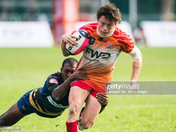Henry Taefu of Western Force tackling Jack Neville of South China Tigers during the Rapid Rugby match between the South China Tigers and Western...