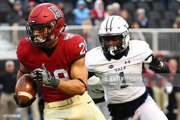 Henry Taylor of the Harvard Crimson runs with the football during a game against the Yale Bulldogs at Fenway Park on November 17, 2018 in Boston,...