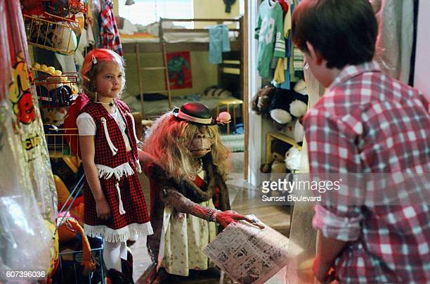 """Henry Thomas and Drew Barrymore on the set of """"E.T.""""."""