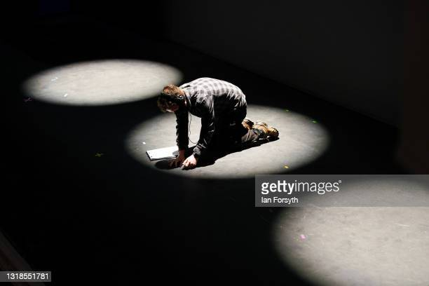 Henry Thomas, Head of Production tapes up on the stage ahead of the opening performance of Love Bites at York Theatre Royal on May 17, 2021 in York,...