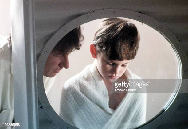 Henry Thomas looking down in a scene from the film 'ET The ExtraTerrestrial' 1982