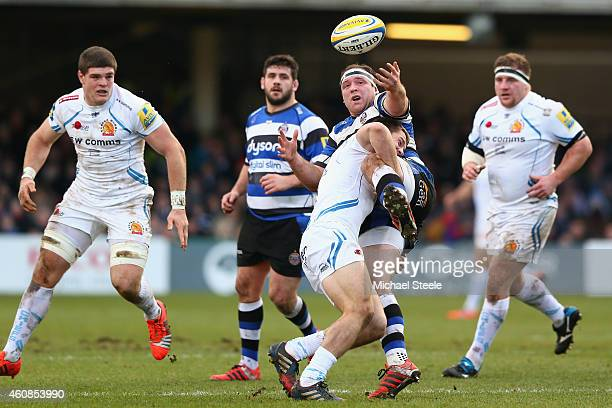 Henry Thomas of Bath loses possession as Sam Hill of Exeter makes the tackle during the Aviva Premiership match between Bath Rugby and Exeter Chiefs...