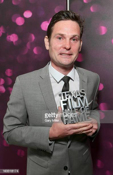 Henry Thomas poses backstage during the Texas Film Hall of Fame Awards at Austin Studios on March 7 2013 in Austin Texas