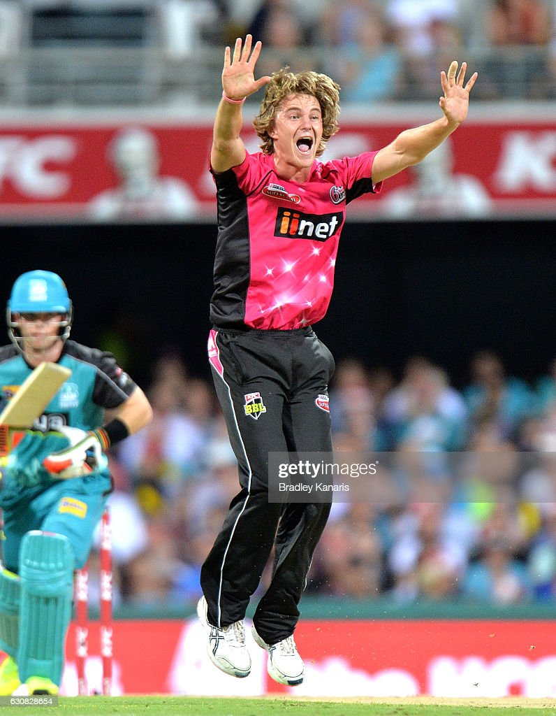 Henry Thornton of the Sixers celebrates taking the wicket of Jimmy Peirson of the Heat during the Big Bash League match between the Brisbane Heat and Sydney Sixers at The Gabba on January 3, 2017 in Brisbane, Australia.