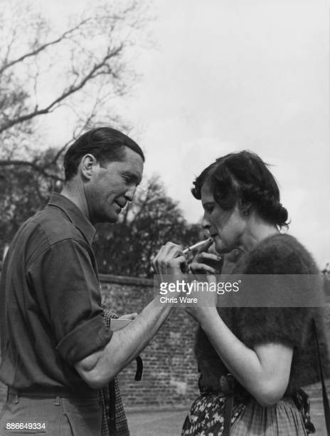 Henry Thynne 6th Marquess of Bath and his wife the Marchioness enjoy a cigarette after showing the public around their home Longleat House in...