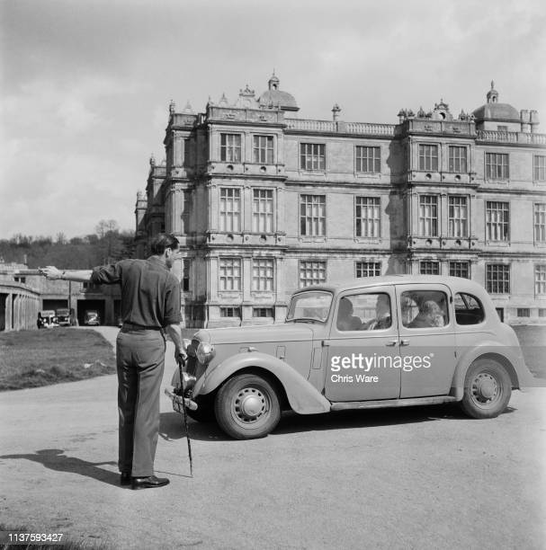 Henry Thynne 6th Marquess of Bath directs a visitor in the car park at his family seat Longleat House near Warminster Wiltshire 22nd April 1949...