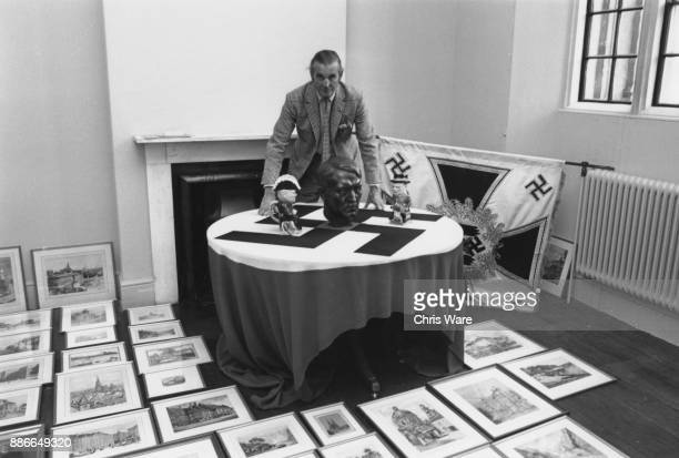 Henry Thynne 6th Marquess of Bath with his collection of paintings by Adolf Hitler the standard borne by Hitler's bodyguard a bust of Hitler and two...