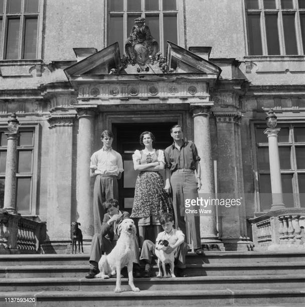 Henry Thynne 6th Marquess of Bath with his family on the front steps of the family seat Longleat House near Warminster Wiltshire 22nd April 1949 With...