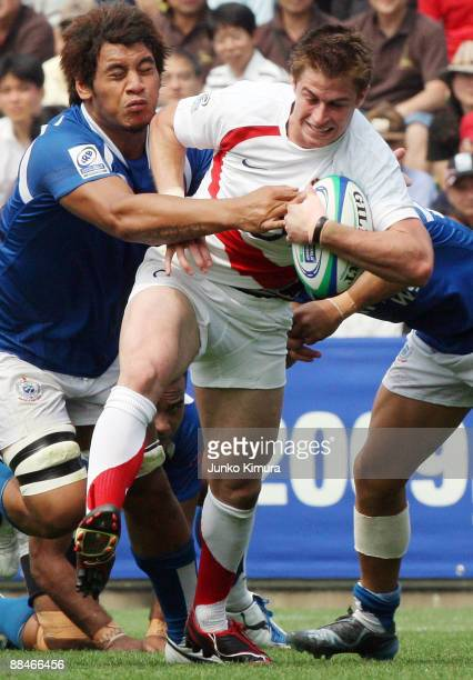 Henry Trinder of England is tackled during the IRB Junior World Championship Japan 2009 match between England and Samoa at Prince Chichibu Stadium on...