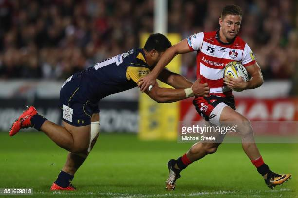 Henry Trinder of Gloucester is held up by Alafoti Faosiliva of Worcester Warriors during the Aviva Premiership match between Gloucester Rugby and...