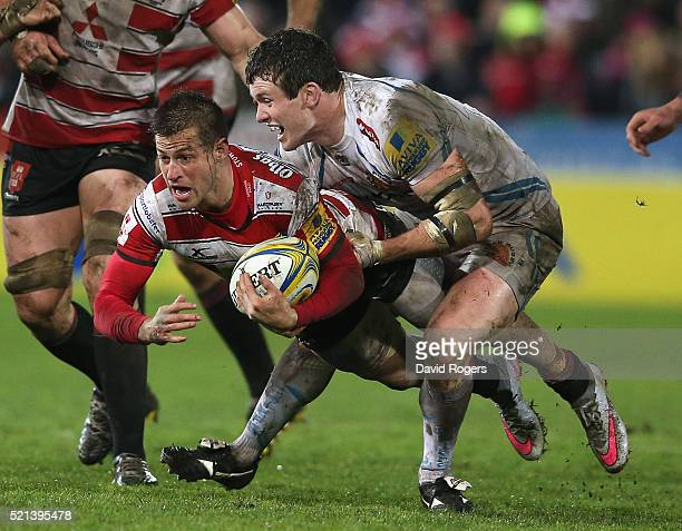 Henry Trinder of Gloucester is tackled by Ian Whitten during the Aviva Premiership match between Gloucester and Exeter Chiefs at Kingsholm on April...