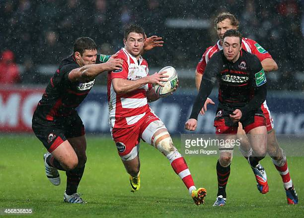 Henry Trinder of Gloucester is tackled by Ross Ford and Grayson Hart during the Heineken Cup pool 6 match between Gloucester and Edinburgh at...