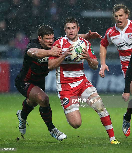 Henry Trinder of Gloucester is tackled by Ross Ford during the Heineken Cup pool 6 match between Gloucester and Edinburgh at Kingsholm Stadium on...