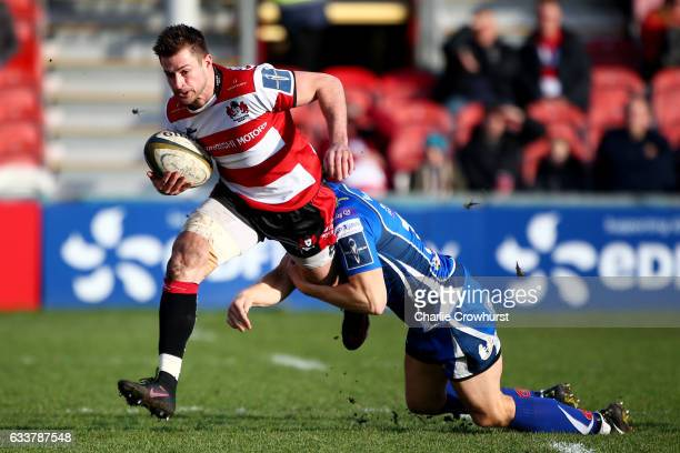 Henry Trinder of Gloucester is tackled by Tom Prydie of Newport Gwent Dragons during to the AngloWelsh Cup match between Gloucester Rugby and Newport...