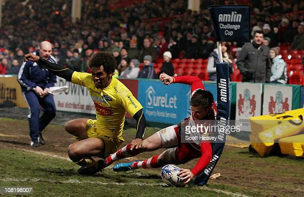 Henry Trinder of Gloucester scores their fourth try during the Amlin Challenge Cup match between Gloucester and Agen at Kingsholm Stadium on January...