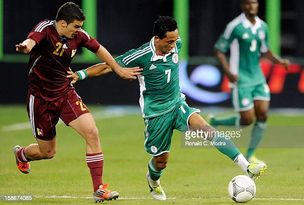 Henry Uch of the Nigeria Soccer Team in action during an exhibition game against the Venezuela National Soccer Team at Marlins Park on November 14...