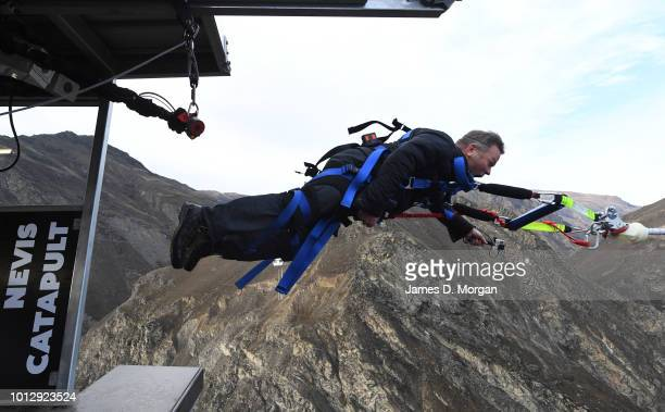 Henry van Asch cofounder of AJ Hackett Bungy New Zealand is launched off the platform as he experiences the world's first human catapult at the...