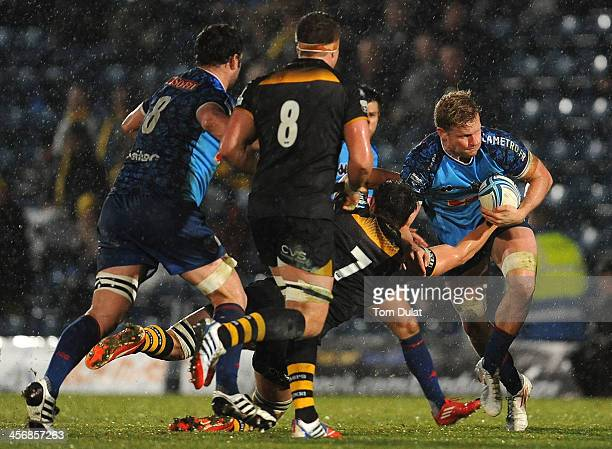 Henry Vanderglas of Grenoble is tackled during the Amlin Challenge Cup match between London Wasps and Grenoble at Adams Park on December 15, 2013 in...