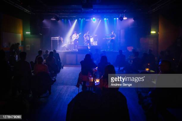 Henry Wade, Esme Dee Hand-Halford and Sidonie B Hand-Halford of The Orielles perform at Belgrave Music Hall on October 04, 2020 in Leeds, England.