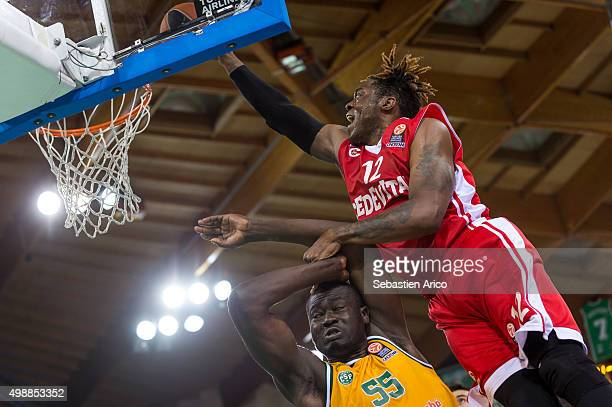 Henry Walker #12 of Cedevita Zagreb competes with Frejus Zerbo #55 of Limoges CSP in action during the Turkish Airlines Euroleague Regular Season...