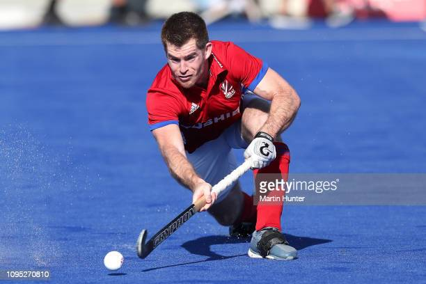 Henry Weir of Great Britain runs the ball during the Men's FIH Field Hockey Pro League match between New Zealand and Great Britain at Nga Puna Wai...